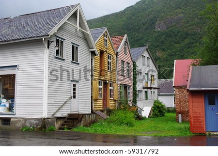 Traditional wooden houses on hillside background in Lyrdal, Norway - stock photo