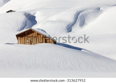 Traditional wooden hut in snow, Alps, Germany - stock photo