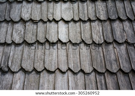 Traditional wooden roof tile of old building - stock photo