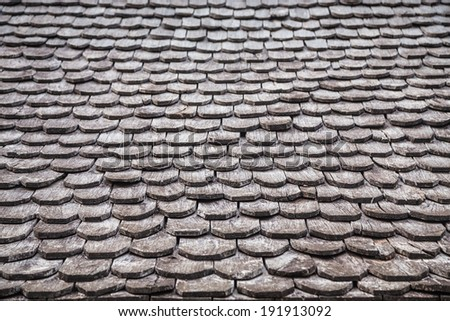 Traditional wooden roof tile of old house  - stock photo