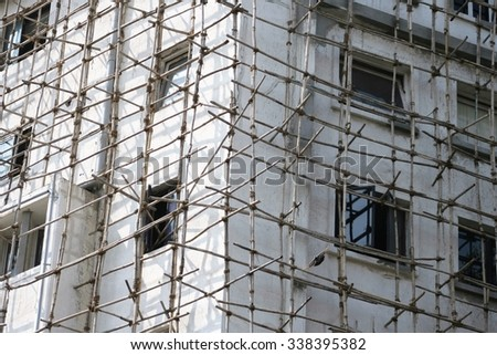 Traditional wooden scaffolding in Mumbai India - stock photo
