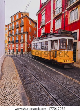 Traditional Yellow Tram on the street of Lisbon, Portugal - stock photo