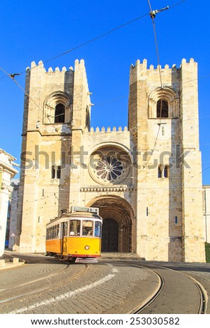 Traditional yellow trams on a street in Lisbon, Portugal  - stock photo