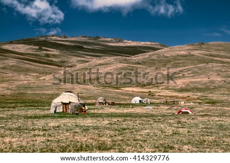 Traditional yurts of nomadic tribes on green grasslands in Kyrgyzstan