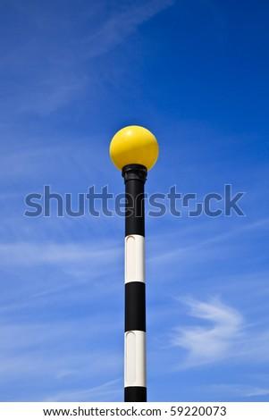 Traditional Zebra Crossing pole with yellow beacon - stock photo