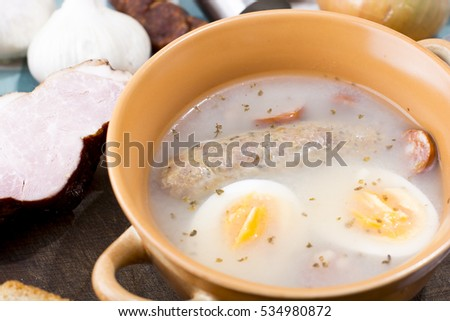 Traditional Zurek with sausage and egg, white borscht, polish Easter soup