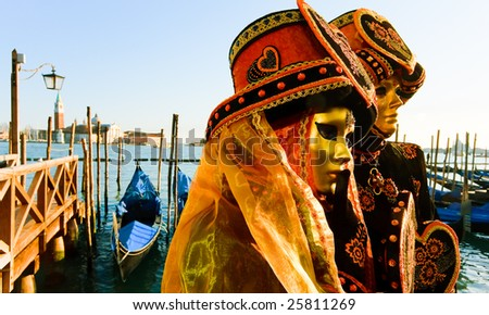 Traditionally dressed Venice carnival couples in Piazza San Marco, Italy - stock photo