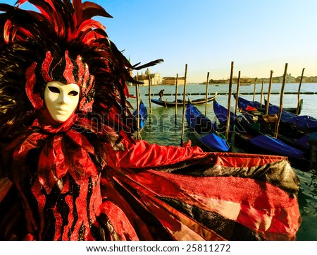 Traditionally dressed Venice carnival person in Piazza San Marco, Italy - stock photo