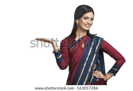 Traditionally Indian woman gesturing - stock photo