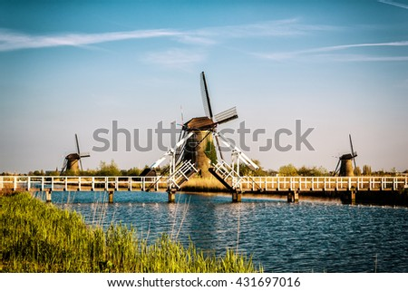Traditionally windmills, Kinderdijk, Netherlands - picturesque landscape with blue sky and water - stock photo