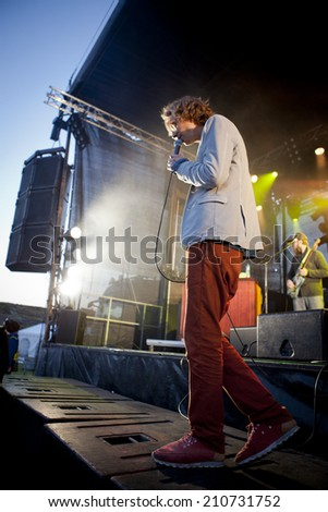 Traena, Norway - July 11 2014: concert of the Norwegian singer and guitarist Erlend Oyefeaturing Icelandic band Hjalmarat at Traenafestival, music festival taking place on the small island of Traena
