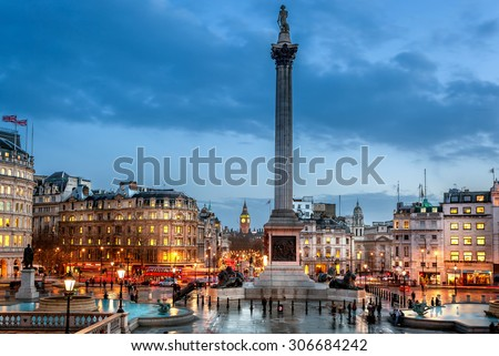 trafalgar Square is a tourist attraction in central London, England. It is home to Nelson's Column, iconic stone lions and Fourth Plinth. It's a must-see destination.  - stock photo