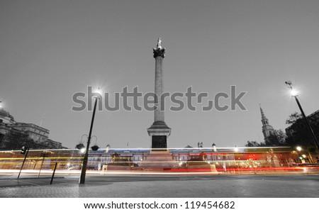 Trafalgar Square with Nelson Column at night - stock photo