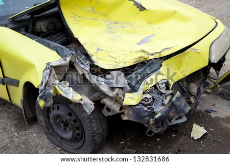 Traffic accident. Yellow crashed car - stock photo