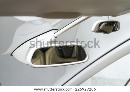 Traffic and back seat child supervision rear view mirrors in a family car - stock photo