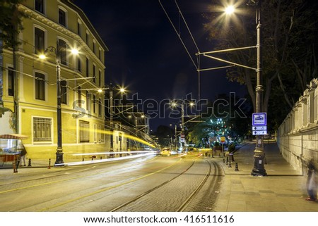 Traffic and lights of tram at night,long exposure. - stock photo