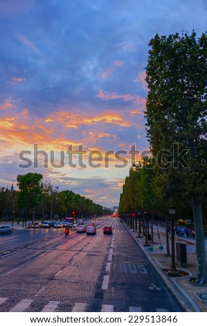 Traffic and tourists  in Champs Elysees Boulevard at sunset - stock photo