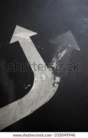 traffic arrow signage on an asphalt road indicating a detour - stock photo
