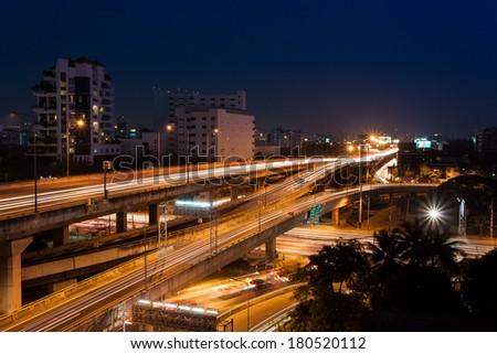 traffic at night in Bangkok city - stock photo