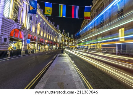 Traffic at night in Regent Street, city of Westminster, London - stock photo