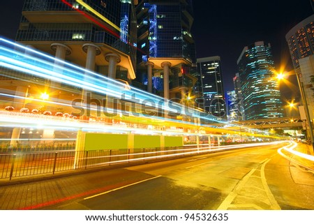 Traffic at night with traces of lights left by the cars on a highway - stock photo