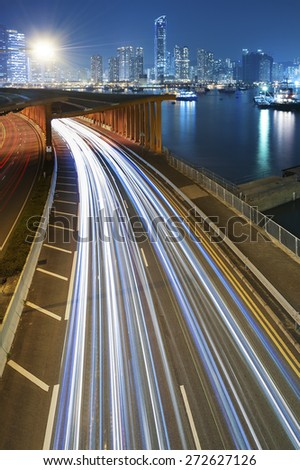 Traffic at night with urban background - stock photo
