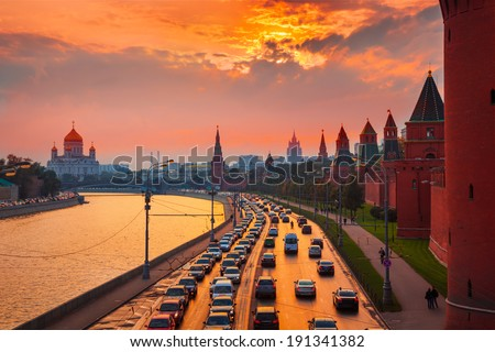 Traffic at sunset near Kremlin wall in Moscow, Russia. - stock photo