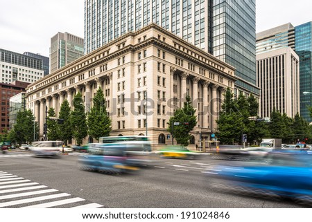 Traffic capture with motion blur in Tokyo business district, Japan - stock photo