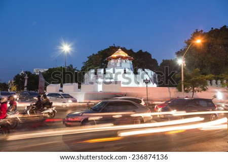 Traffic captured at night with blurred motion in front of the Parapet Mahakan fortress in Bangkok, Thailand capital city - stock photo