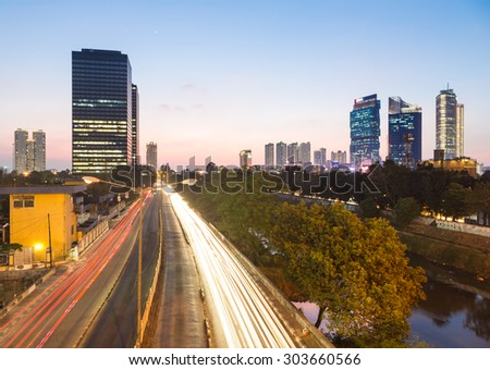 Traffic captured with long exposure along one of the city main avenue in the Central Business District after sunset in Jakarta in Indonesia capital city.