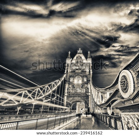 Traffic car lights across Tower Bridge under a beautiful sunset sky, London. - stock photo