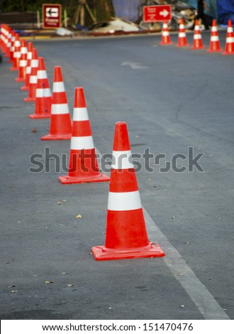 Traffic cone on a parking lot in the park. - stock photo