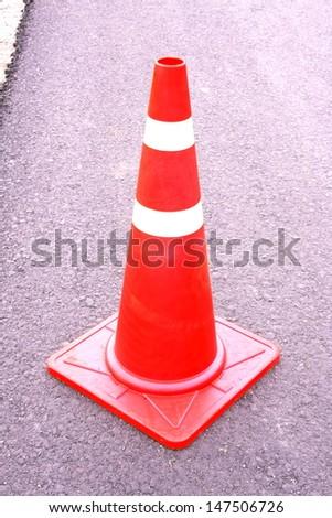 traffic cone on asphalt road /building road - stock photo