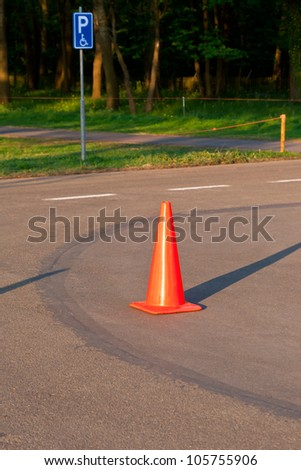 Traffic cone on the parking for disabled people - stock photo