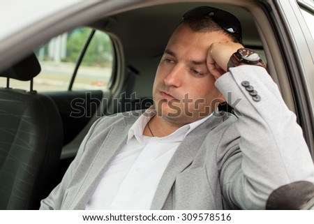 Traffic congestion and a business man in the car - stock photo