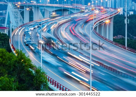 traffic flow closeup on the curve bridge - stock photo