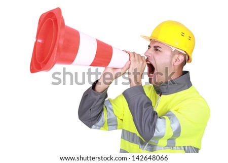 Traffic guard screaming into a pylon - stock photo