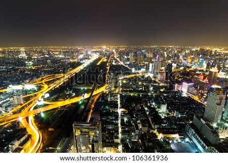 Traffic in Bangkok by night - stock photo
