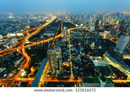 Traffic in Bangkok, capital city of Thailand at twilight - stock photo