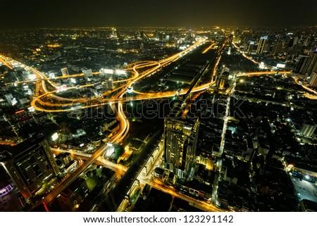 Traffic in Bangkok, capital city of Thailand at twilight - stock photo