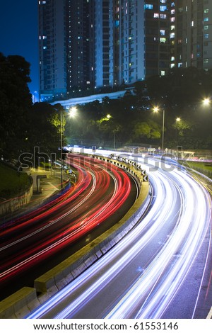 traffic in city at night in hong kong. - stock photo