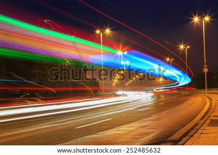 traffic in city on bridge - stock photo