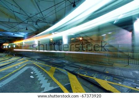 Traffic in Hong Kong downtown at night - stock photo