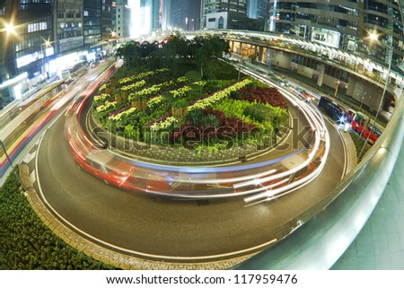 Traffic in roundabout in Hong Kong at night