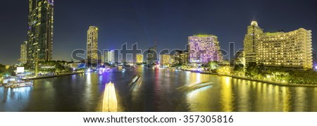 traffic in the river on night city skyline background, long exposure used, panoramic view