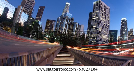 Traffic into and out of Los Angeles with traffic seen as trails of light - stock photo