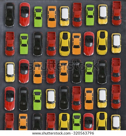 Traffic jam concept with multiple toy cars on a blackboard - stock photo