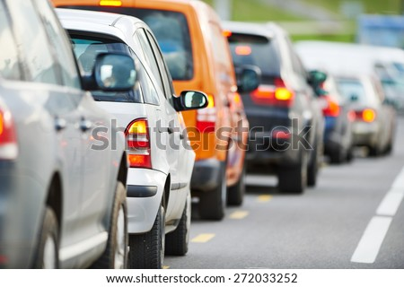 traffic jam in a city street road during rush hour  - stock photo