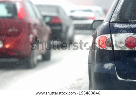 traffic jam in the city at winter time - stock photo