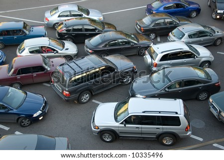 Traffic jam on the road, a lot of cars which go towards each other and to the different directions - stock photo